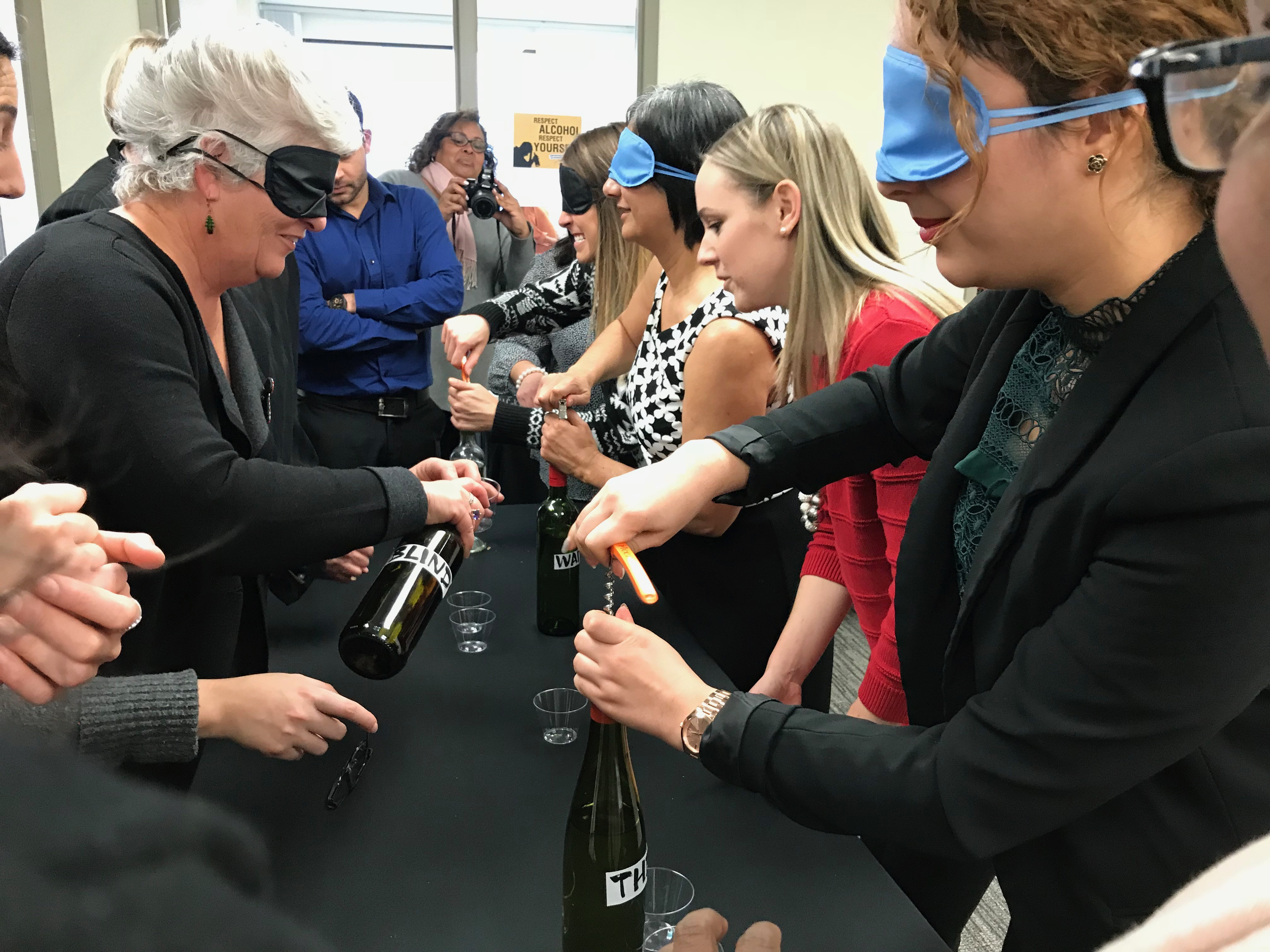 wine tasting games being played while participants are blindfolded