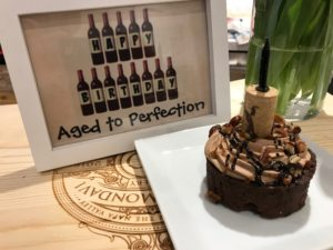 birthday cake with wine cork as candle